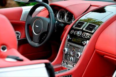 Aston Martin DB9 Features: leather interior, sport steering wheel