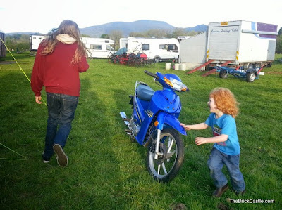 boys chasing around a motorbike