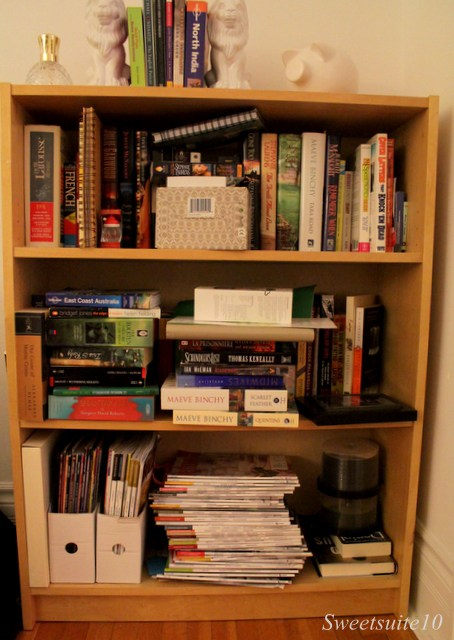 an over-full bookcase