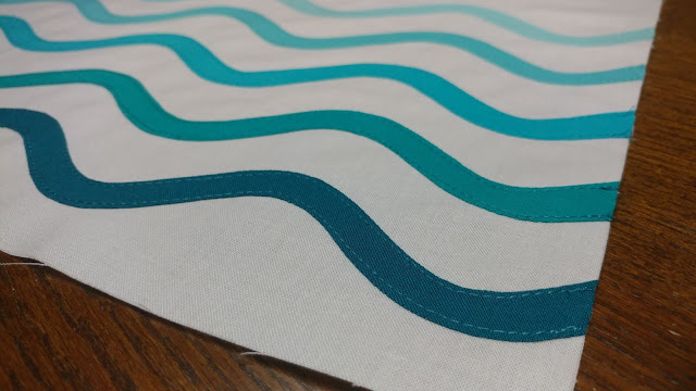 Ocean waves quilt block using raw-edge applique