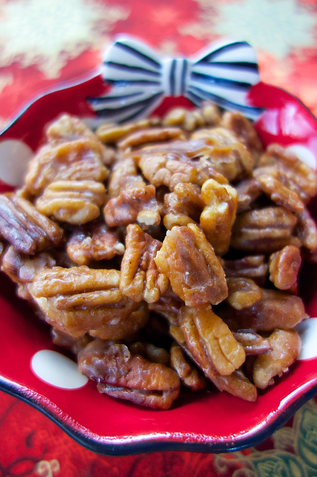 Peppered Glazed Pecans - you'll want to double the recipe - they go fast! Pecans coated in brown sugar, butter, corn syrup, pepper and salt. Great for snacking on at holiday parties! Also makes a great homemade gift! Everyone LOVES this easy snack recipe!
