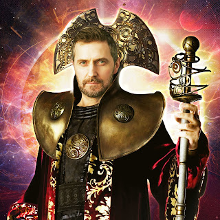 Actor Richard Armitage in Rasillon's costume of cloak and metal headpiece