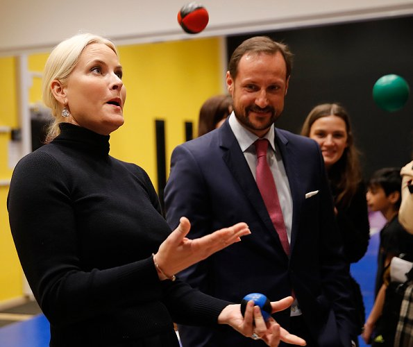 Crown Prince Haakon and Crown Princess Mette-Marit of Norway visited Bjerke District in Oslo. Princess Mette Marit wore Zara cape