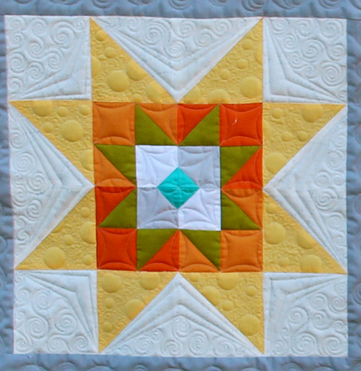Celaeno Star Block designed by Gina Perkes of The Copper Needle for the National Quilters Circle Quilt Block Challenge