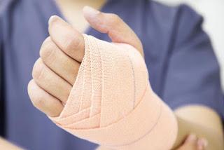 Bandaged injured hand