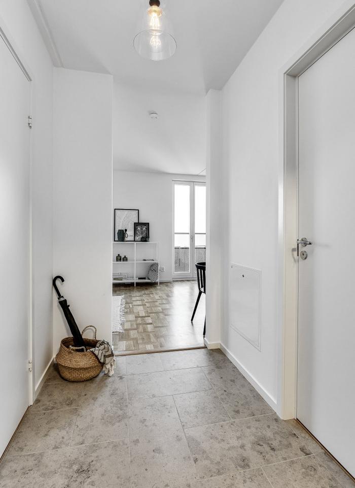 recibidor apartamento decoracion blanco y negro