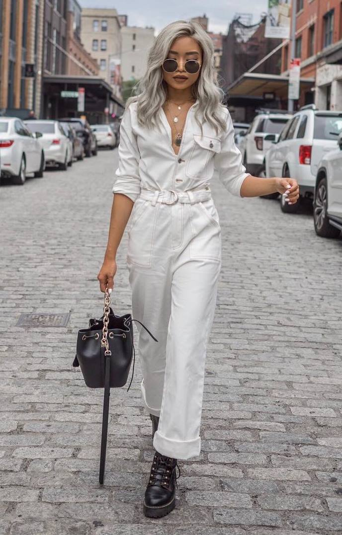 fall fashion trends / white jupsuit + bag + boots