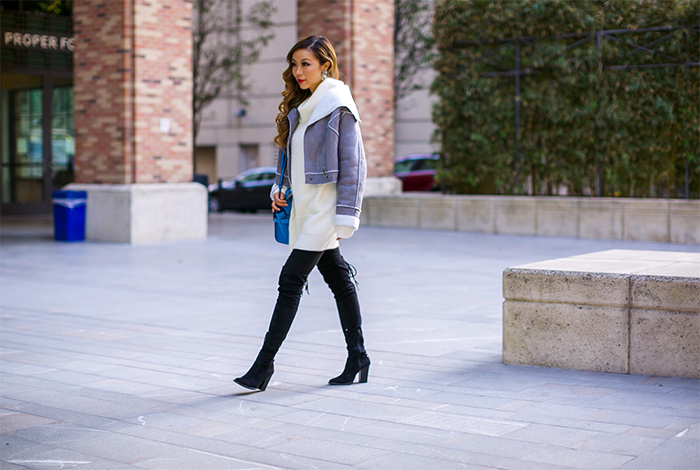 faux shearling jacket, shearling jacket, zipper sweater, 7fam skinny jeans, henri bendel  uptown mini satchel bag, steve madden over the knee boots, over the knee boots, baublebar earrings, baublebar halcyon crystal drops, holiday outfit ideas, holiday outfit on a budget, san francisco fashion blog, san francisco street style