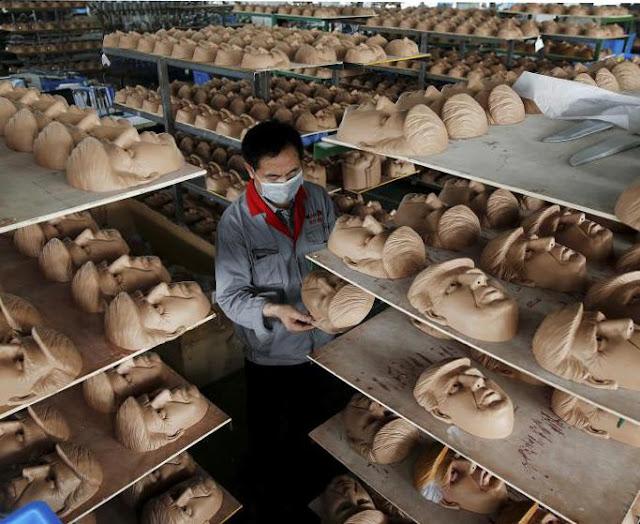 ট্রাম্প-ক্লিন্টনদের মুখোশ বানাচ্ছে চীন