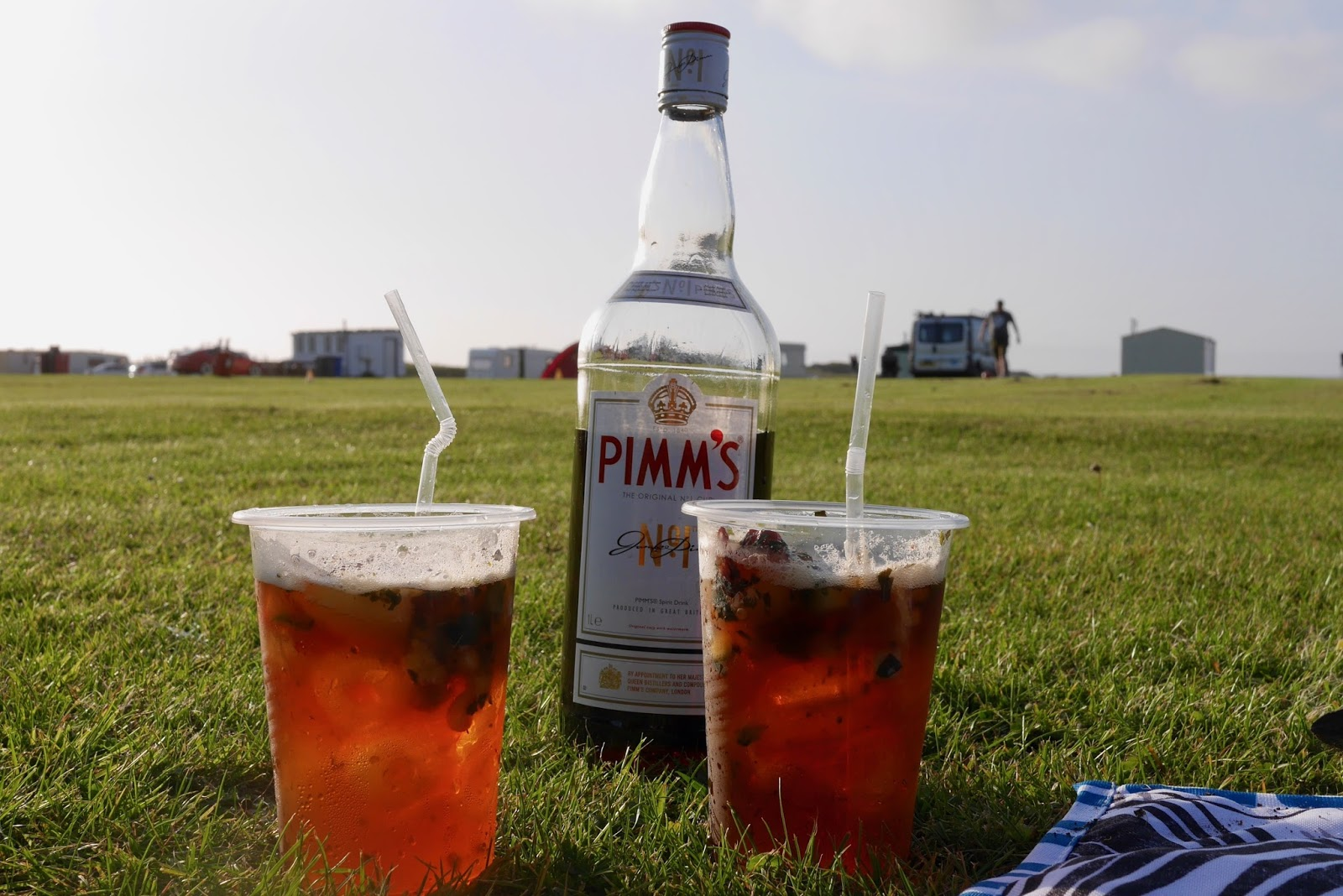 Drinking some Pimms at the campsite with fruit, www.calmctravels.com