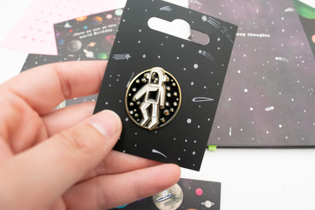Astronaut black and gold enamel pin