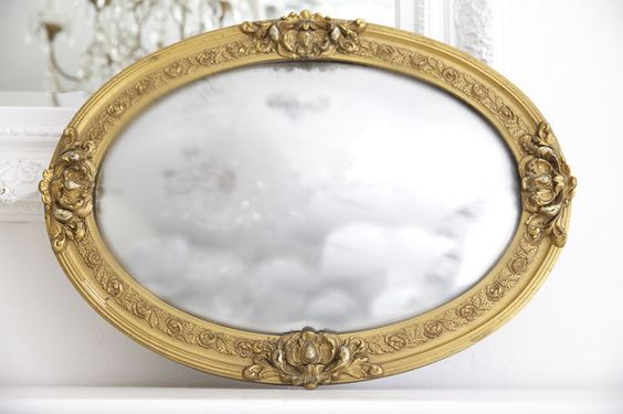antique ghosted mirror with patina