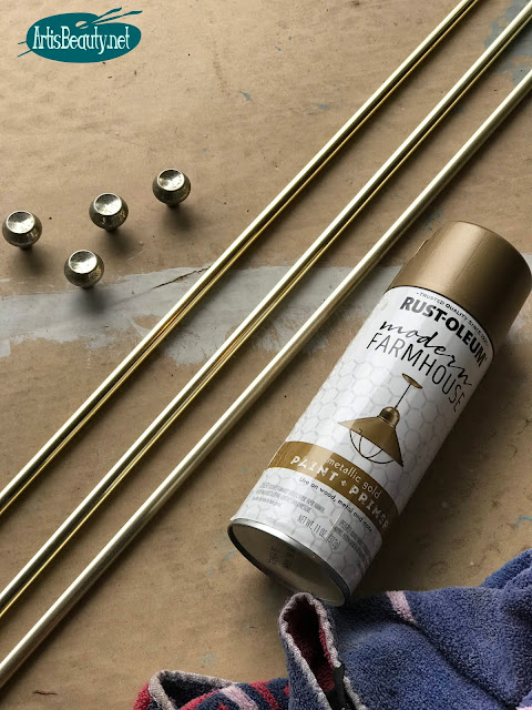 farmhouse gold spray paint by rustoleum for making over hardware on a mcm dresser