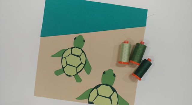 Turtle Beach quilt block using raw-edge applique and solid fabrics