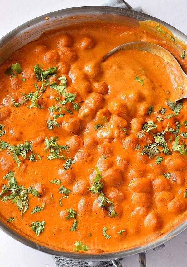 creamy vegetarian roasted chickpea tikka masala closeup with chopped cilantro.jpg
