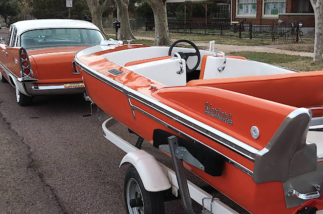 a 1957 DeSoto Fireflite with trailer and Herters powerboat