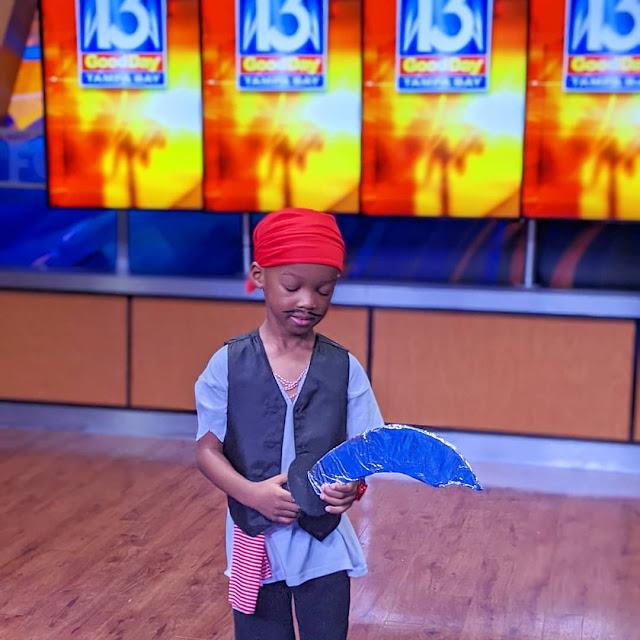 African American preschool boy dressed up for Gasparilla
