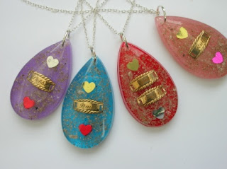 A selection of colourful and personalised memorial pendants