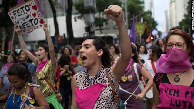 "Women protesting violence against women in Rio de Janeiro, Brazil, on November 28, 2017.   ""Brazil, an American country is now known for its violence  and hatred against females.""   (GYL)- According to a new study released on Tuesday, September 2019, by non-governmental organization Brazilian Forum of Public Security, which found that violence against women and girls is worsening in the country.   In Brazil, four girls under 13 are raped every hour and every two minutes police receive a report of violence against women.   Presently, Brazil which is known as the living place of over 200 million people has been labeled as one of the most dangerous place for any woman to be.   The report shows that the murder of women for just being a woman increased by 4% last year on the previous year, even as the national homicide rate fell 10.8%. In 88% of those cases, the perpetrator was the woman's partner or former partner.                                  models portraying women who have been abused at a demonstration opposing violence against women on Copacabana beach in 2016.    Over 263,000 women suffered serious injuries at the hands of their partner, according   to the study, which was based on governmental data.   The country also saw the largest ever number of reported rapes, and almost 54% of the victims were girls under 13 years old."