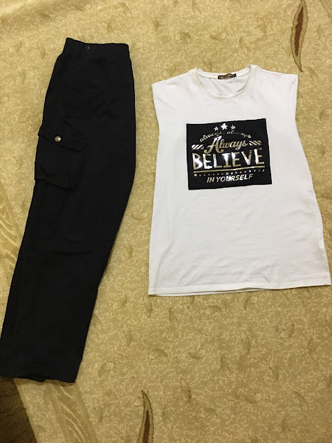 A shirt with a black trouser