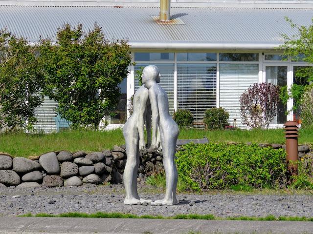 Two silver modern art statues hugging in Seltjarnarnes, Reykjavik, Iceland