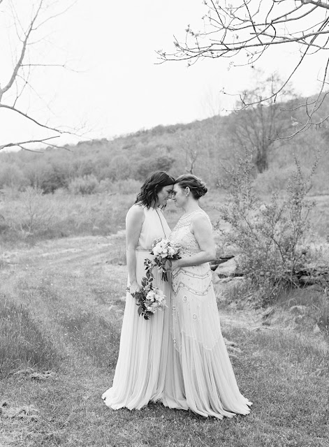 Two brides Jonna and Heather in the yard at their Inn at West Settlement Wedding by Karen Hill Photography