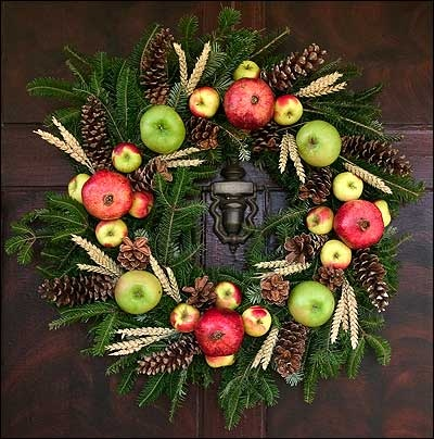 Christmas wreath with pomegranates and wheat.