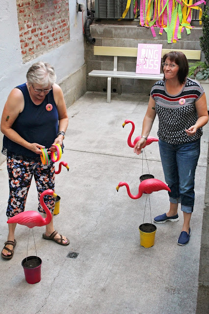 Having fun with flamingo ring toss at Fizzy Party Trop Fest