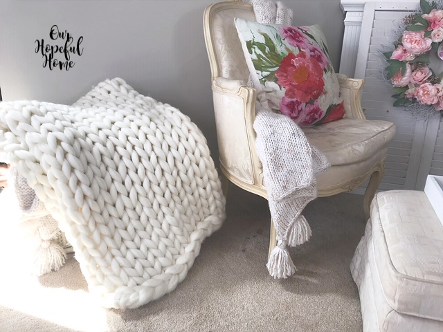 Bergere chair chunky knit blanket tasssels ottoman