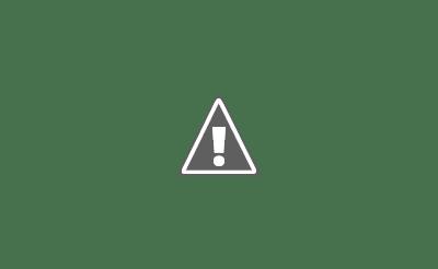 Fotografía de una persona con diversidad funcional auditiva hablando en lengua de signos con otra