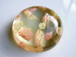 Wedding petal confetti preserved within a paperweight