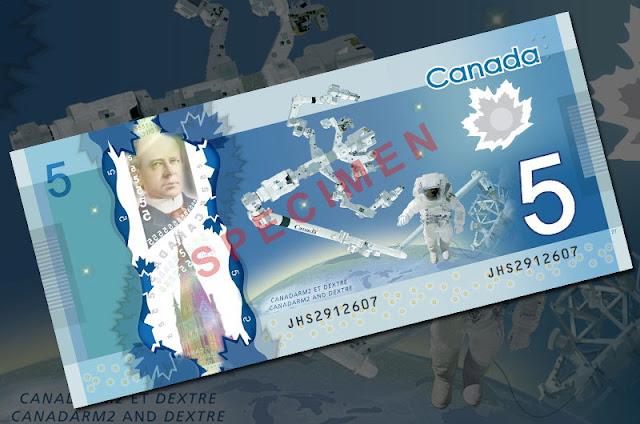 nota de 5 dolares canadense com braço robótico canadarm