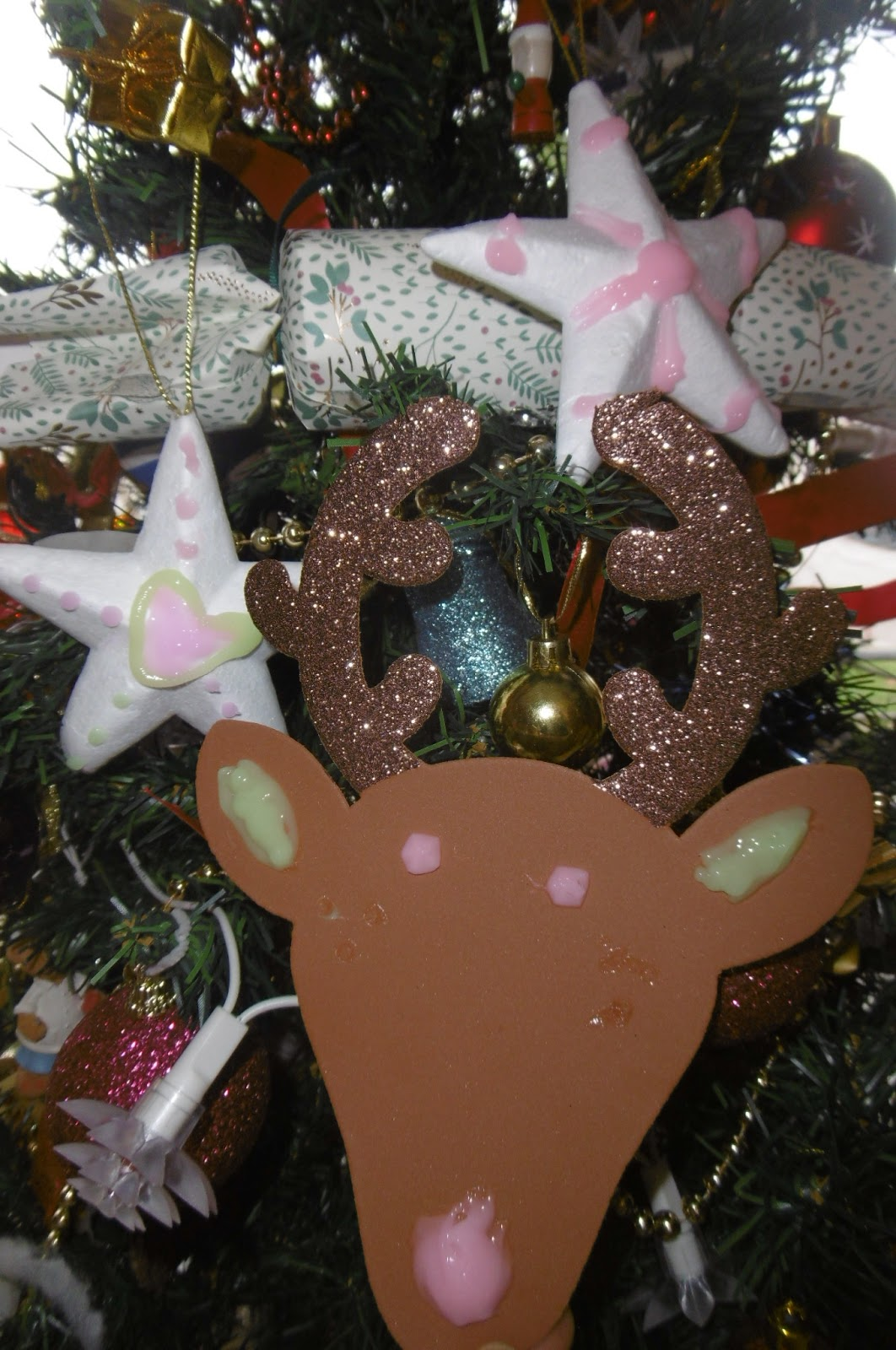 they were very proud to add their finished designs to the christmas tree once theyd dried and i think they look fantastic