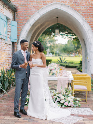 bride and groom at dinner setup
