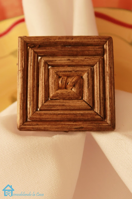white cloth napkins on yellow plate with brown napkin ring