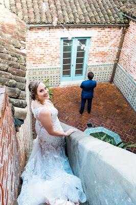 Bride walking down stairs for first look