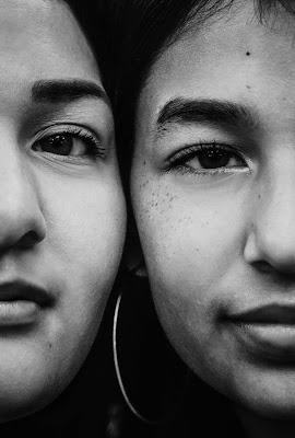 BLACK AND WHITE Teenage sisters close up face portrait for Christmas mini sessions with Morning Owl Fine Art Photography located in San Diego.