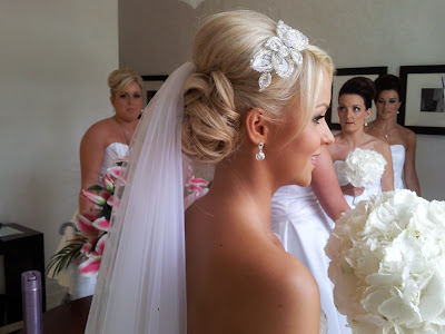Blonde Bride showing her wedding hair and wedding dress before leaving for her ceremony