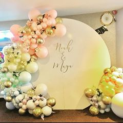 Round white backdrop with organic gold balloon arch and personalize backwall