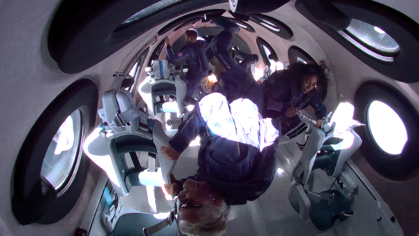 Virgin Galactic founder Sir Richard Branson and his three Unity 22 crewmembers float around inside VSS Unity's cabin during their 53.5-mile (86-kilometer) journey into space...on July 11, 2021.