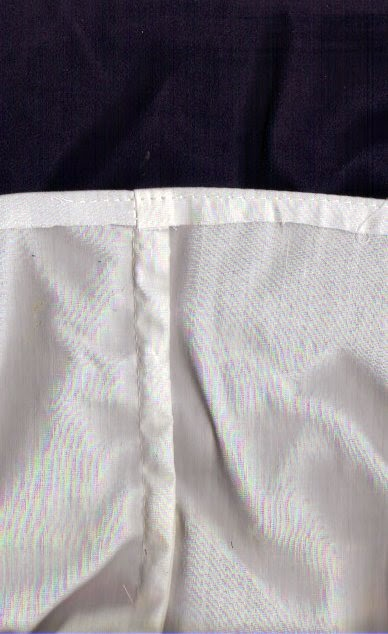 French seam from inside with folded top edge and edge stitching