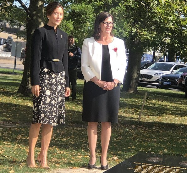Crown Princess Mary wore a black and white floral dress from Ralph Lauren, and a structured mock-neck blazer from Max Mara. Naledi Gianvito Rossi