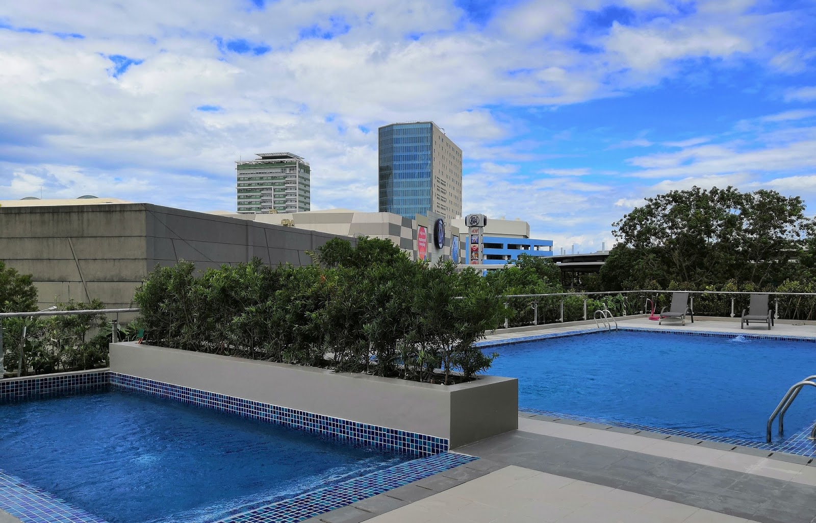 Swimming pool for adults and kids at Park Inn Iloilo.