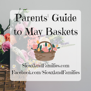 """in background, pinkish flowers fill a brown wicker basket. in foreground, the words """"parents guide to may baskets"""""""