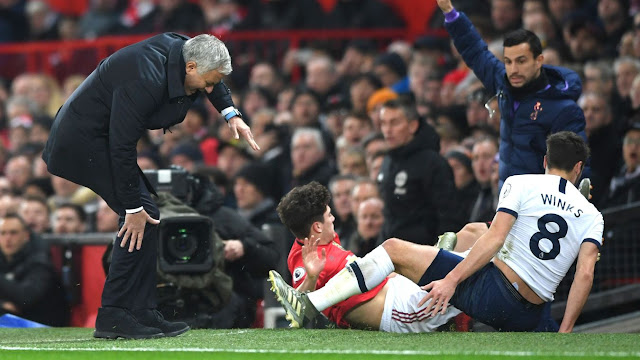 Jose Mourinho grimaces in pain after an accidental collision with Daniel James during Manchester United 2-1 Tottenham Hotspur in the Premier League