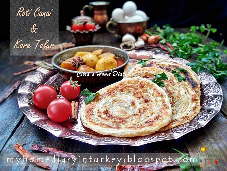 "Roti Canai / Paratha / Roti Maryam, ""flying flat bread"""