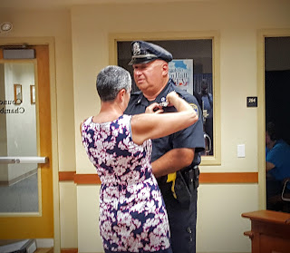 Patrolman Paul Fiorio gets badge #1 as the longest serving officer