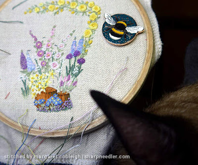 Beginning to add pink flowers to the small pot on Lorna Bateman's embroidered scissors keeper