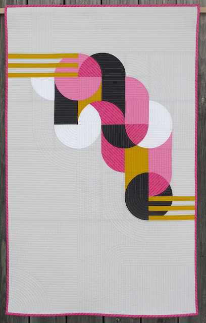 Luna Lovequilts - Bubble Gum - A modern quilt inspired by a geometric Street Art work