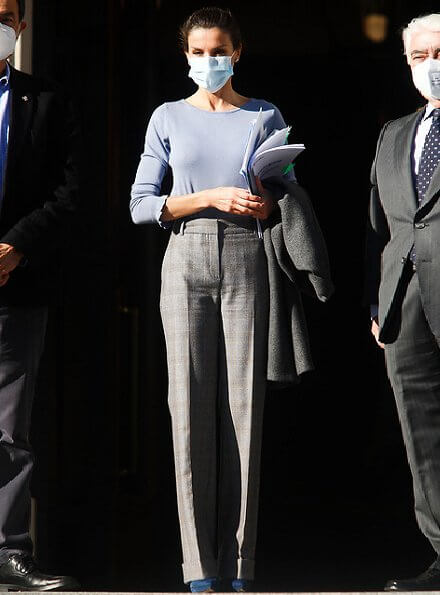 Queen Letizia wore a large plaid trousers from Massimo Dutti, and blue bell sleeve round neck ruffle cuff jersey sweater. Magrit pumps